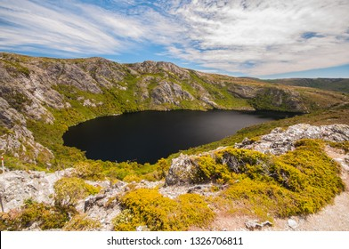 The top view of Crater Lake, the deep blue color beautiful mountain lake which is carved out by glaciers a millennia ago, in Cradle mountain of Tasmania, Australia.