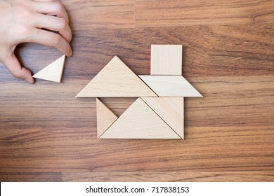 Top view of creating or building home from wooden puzzle piece. Dream home concept. Idea and success. Minimal style.