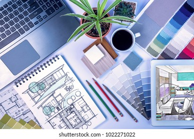 Top view of creative's (architect & interior designer) desk with laptop, tablet, drawing sketch / Home renovation & decoration concept