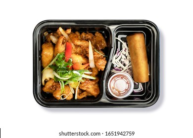 Top View of Crispy Chicken sautéed with sweet and sour sauce with Spring Roll in Takeaway Box on White Background. Asian Food. Delivery Food. Clipping Path on the main object (not the shadow) Included