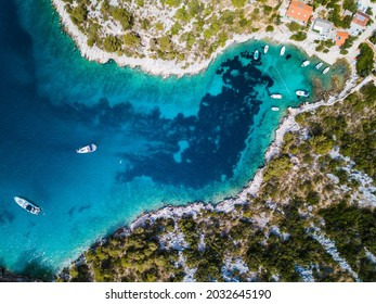 top view of an croatian bay with boats taken with a drone