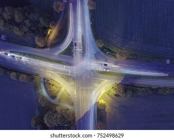 Top view of cross road with light trails