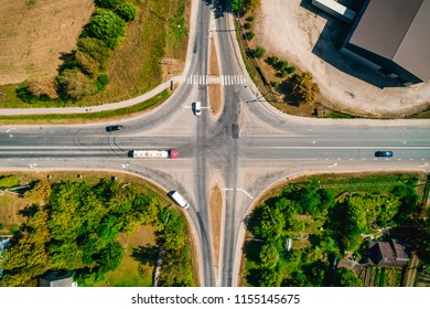 Top view of crossroad with cars in a small city. Aeriaal photo.