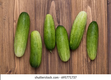 Top view of Cucumber on wood texture background