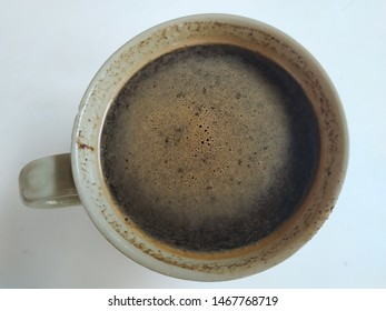 top view of cup of black coffe on white background