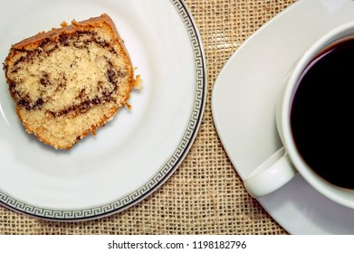 Top view of a cup of coffee and a slice of cake