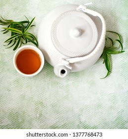 Top view a cup of tea and chinese teapot. Free space for your text.