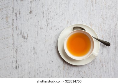 Top view of cup of tea on white vintage background