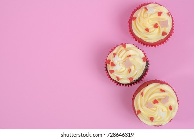 Top view of cupcakes in pink color background with empty space for text