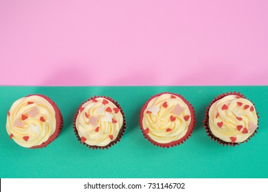 Top view of cupcakes in pink and green background with empty space for text