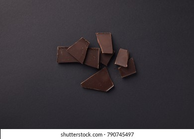 top view of dark chocolate bars on grey surface