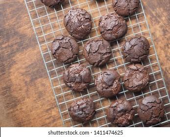 Top view dark chocolate cookies on wooden table.