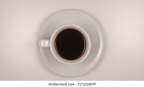 TOP VIEW: Dark coffee in a white coffee cup