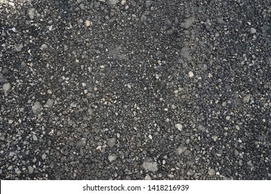 Top view of the dark gray scree rock street