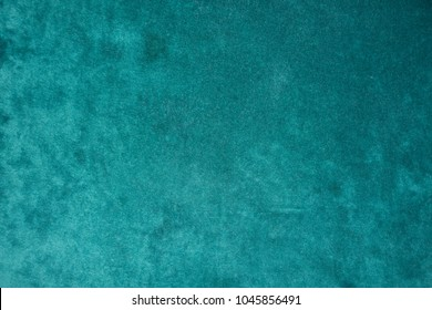 Top view of dark green velour fabric
