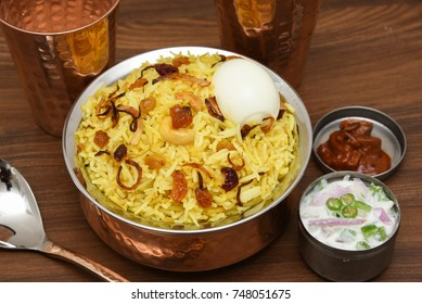 Top view of delicious Arabian Mutton Dum Biriyani,  made with basmati rice, spices. Yogurt, pickle side dish  for Ramadan, Eid festival Saudi Arabia, Dubai.