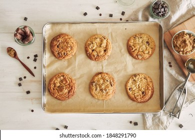 A top view of delicious chocolate chips cookies on an oven tray