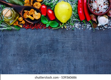 Top view of delicious ingredients for healthy cooking or salad making on slate vintage background. Bio Healthy food, herbs and spices. Organic vegetables on slate. Cooking or vegetarian food concept.