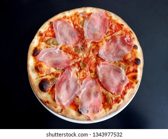 top view of delicious Italian pizza with ham