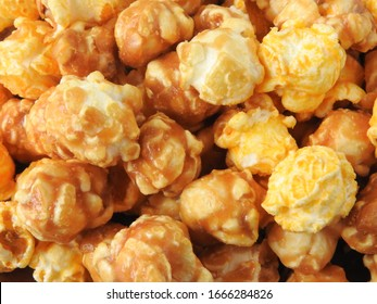 Top view of delicious popcorn full of frame. Include buttery caramel corn and rich cheddar cheese corn.  Popcorn background. Food and snack concept.