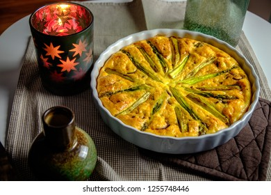 Top view of delicious quiche made with eggs and asparagus, in baking form