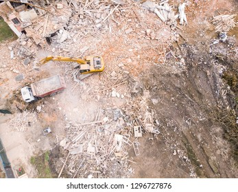 top view of demolition site. destruction of old building. heavy machinery clearing out construction site