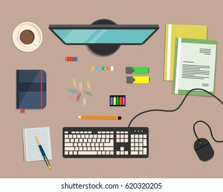 Top view of a desk background, where there is a monitor, keyboard, computer mouse, color folders, markers, other stationery and cup of coffee. Raster copy