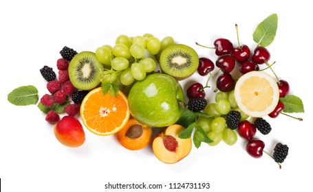 Top view of different fruits: apple, grape, orange, apricot, cherry, lemon, kiwi and nectarine decorated with mint isolated on white background. Summer fruits  concept.