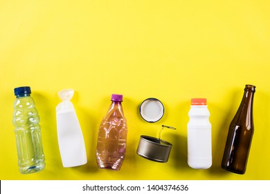 Top view of Different garbage materials for recycling on yellow background. Recycle, World Environment Day and Eco concept