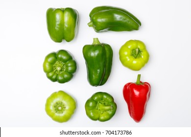 Top view of different kinds of peppers: green pepper, red paprika, on white background. Minimal style.