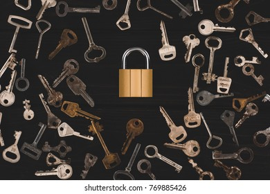 top view of different metal keys with lock isolated on black