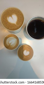 Top view of different type and size of coffee in paper cup, clockwise: caffe latte, americano, piccolo, and flat white.
