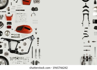 Top view of disassembled motorcycle on a light background with copy space