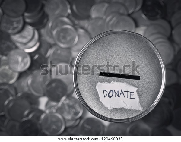 top view of donation box for charity with money coins in black and white.