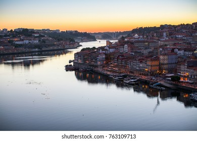 Top view of Douro river and Ribeira promenade at dusk. Porto, Portugal.