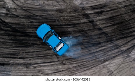 Top view drifting car, Aerial view professional driver drifting car on race track.