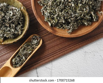 Top view of dry mugwort on bamboo mat. Be used to ward off evil spirits and to drive away mosquitoes during the Dragon Boat Festival in Taiwan.  Chinese herbal medicine. With copy space.