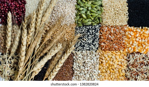 Top view of dry wheat on natural cereal food background consisted of red bean,rice,millet,pumpkin,flax seed,white and black sesame,corn,job's tear,and soybean in low key tone