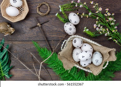 Top view easter background.Happy easter eggs painted also rabbit and cross on nest.Texture rustic wooden with decorations flowers and copy space.