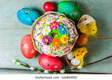Top view of Easter Cake and Easter eggs hand painted in home wooden background