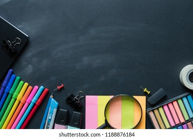 Top view of educational and office supplies on black background. Top view with copy space.
