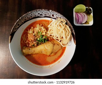 Top view of Egg Noodle in Chicken Curry or in another name in Thai language is Kao Soi Kai. Traditional recipe of Northern Thailand. Food concept.