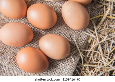 Top view of eggs on the table with straw
