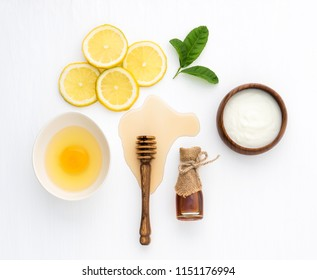 Top view of egg,yogurt,honey and lemon on white background in concept simple homemade hair mask.Natural hair care recipe with essential oils.Best natural hair care for long, strong and beautiful hair.