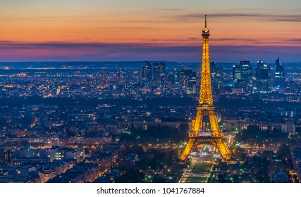Top view of Eiffel tower decorated with orange light after sunset on April 10, 2017 in Paris,France .