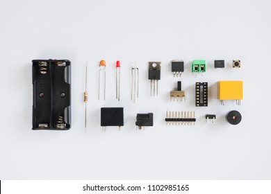 Top view of electronics component such as resistor, ICs, capacitor, switch, LED, battery case, relay and connector.