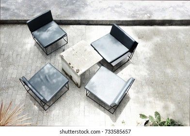 Top view of empty Cement tables and chairs on a balcony vintage style.