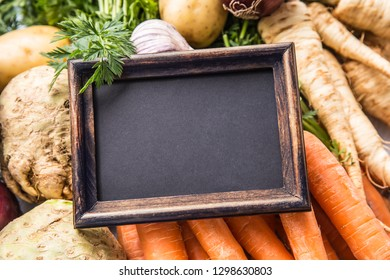 Top of view empty chalkboard on fresh vegetables.