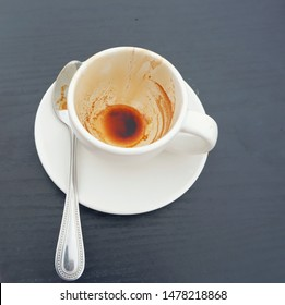 Top view of empty coffee in Coffee cups with spoon were consumed that have already been consumed , americano coffee cup on wooden table.Close up.