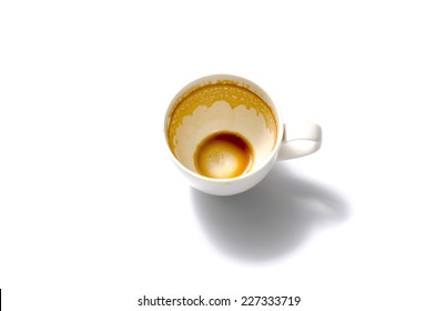 top view empty and dirty cup of coffee on a white background